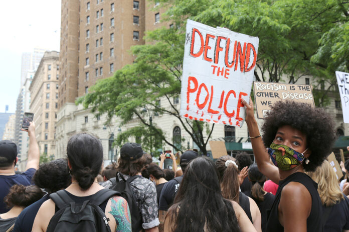 """PROTESTERS march in New York City on June 6. Calls to  """"defund the police"""" have spread nationwide in the wake of the death of George Floyd while in police custody last month in Minneapolis. / AP FILE PHOTO/RAGAN CLARK"""