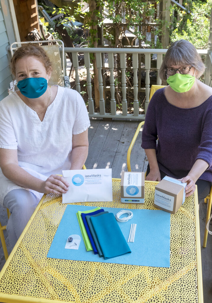 MADE IN R.I.: Cynthia Treen, left, and Clare King, co-owners of isewMasks, use locally sourced materials from Rhode Island-based companies in their do-it-yourself mask-making kits. / PBN PHOTO/MICHAEL SALERNO