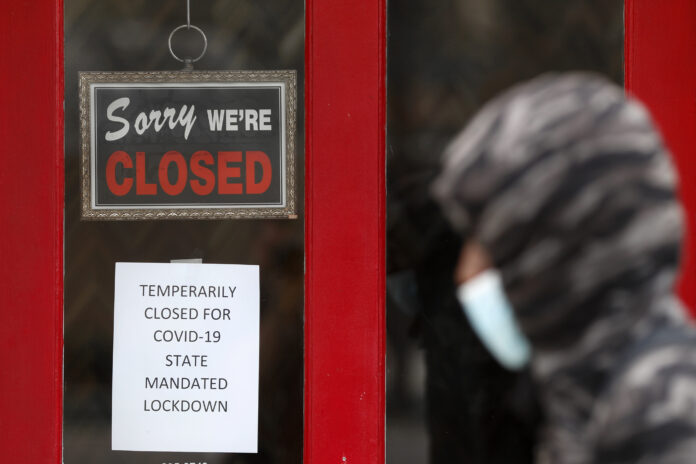 RHODE ISLAND UI filings due to COVID-19 increased by 590 on Tuesday. / AP FILE PHOTO/PAUL SANCYA