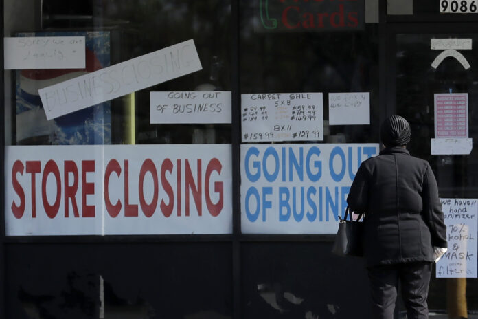 U.S. EMPLOYERS laid off 7.7 million workers in April while job openings declined 16% month to month. / AP FILE PHOTO/NAM Y. HUH
