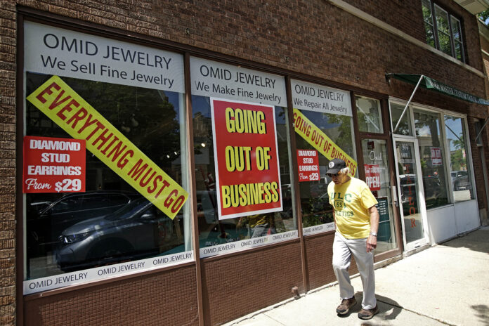 U.S. JOBLESS CLAIMS totaled 1.48 million last week. / AP FILE PHOTO/NAM Y. HUH