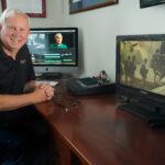 JIM KARPEICHIK, owner and president of Ocean State Video Inc., in his home office during the coronavirus pandemic. / COURTESY JIM KARPEICHIK