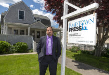 OUT OF POCKET: Robert Berczuk, publisher of The Jamestown Press, says the money his newspaper is losing as a result of a 33% decline in ad revenue is coming directly out of his pocket, but he has assured his staff of six that there will be no pay cuts, layoffs or furloughs. / PBN PHOTO/MICHAEL SALERNO