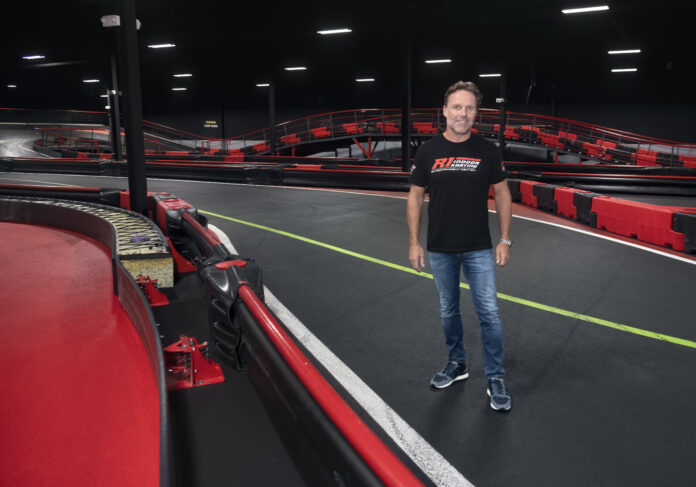 MIKE HEZEMANS, owner, R1 Indoor Karting in Lincoln, stands in the middle of his go-kart track. Hezemans confirmed Monday that his facility reopened for business Friday to limited capacity, arguing that his facility should reopen if Twin River Worldwide Holdings Inc. reopened its casinos, PBN PHOTO/MICHAEL SALERNO