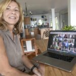 VIRTUAL COMPANY: Leonora Valvo, founder and director of Warren-based Swoogo, coordinates a videoconference staff meeting from her computer. / PBN FILE PHOTO/MICHAEL SALERNO