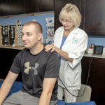 FINDING A WAY FORWARD: Victoria Malchar, owner of Malchar Wellness Center, treats Brandon Maced at her Warwick offices, where she and her staff offer a number of coaching and therapy options. / PBN FILE PHOTO/MICHAEL SALERNO