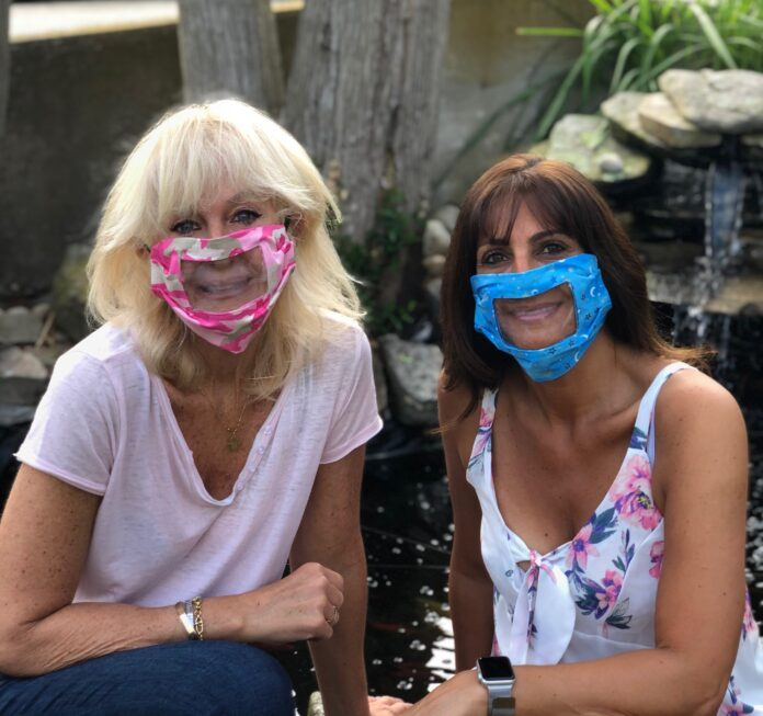 LOCAL TEACHERS Linda Harnois, left, and Linda Greco have created face masks with clear covering to allow faces to remain visible while wearing them. / COURTESY LINDA GRECO