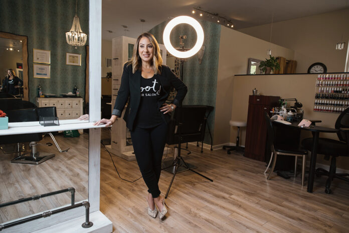 STAYING TOGETHER: Roots Hair Salon owner Michelle Murphy retained 17 hairstylists from when Salon O closed at the location that Roots currently occupies. Murphy wanted to maintain camaraderie among the stylists. / PBN PHOTO/RUPERT WHITELEY