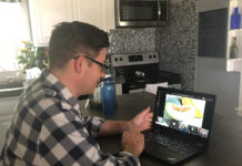 "PLAY TIME: Jeremy Girard, director of marketing at Envision Technology Advisors, participates in a trivia game from his home during the company's ""Friday Funday."" / COURTESY JEREMY GIRARD"