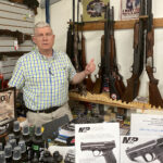 UP IN ARMS: Despite an anticipated 40% increase in annual sales due to the COVID-19 pandemic, Dean Chapman, owner of gun stores Pheasant Ridge Inc. in Seekonk and River Street Tactical Inc. in Woonsocket, was not happy when he was forced to close his Seekonk store after initial stay-at-home orders in Massachusetts did not deem gun stores as essential ­businesses. / PBN PHOTO/NANCY LAVIN