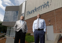 DIVERSE WORKFORCE: C.C. Business Corp. Vice President Ron Brewer, left, and President Marcellus Sharpe stand outside of Thundermist Health Center in Woonsocket, one of the private-security company's clients. Brewer estimates that 70% of the company's 39 employees are minorities. / PBN PHOTO/RUPERT WHITELEY