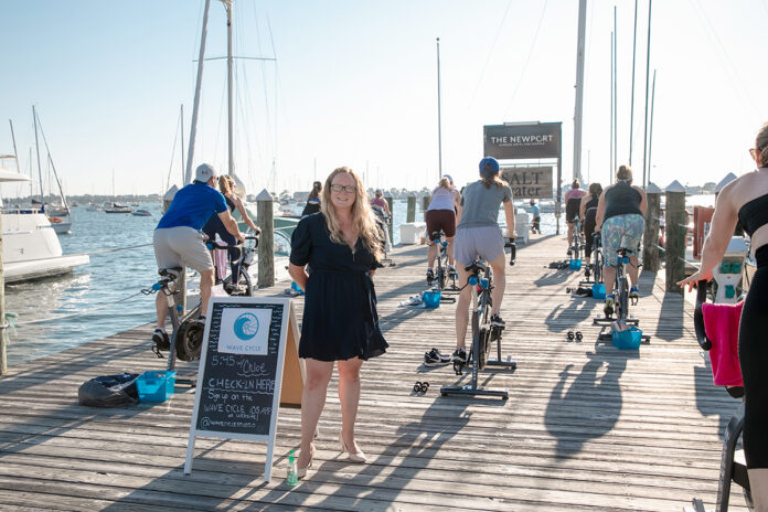 HOME FOCUS: Ella Gonzalez, Newport Harbor Hotel and Marina director of sales and marketing, stands on a pier where the hotel is hosting a fitness studio's cycling classes. / PBN FILE PHOTO/TRACY JENKINS