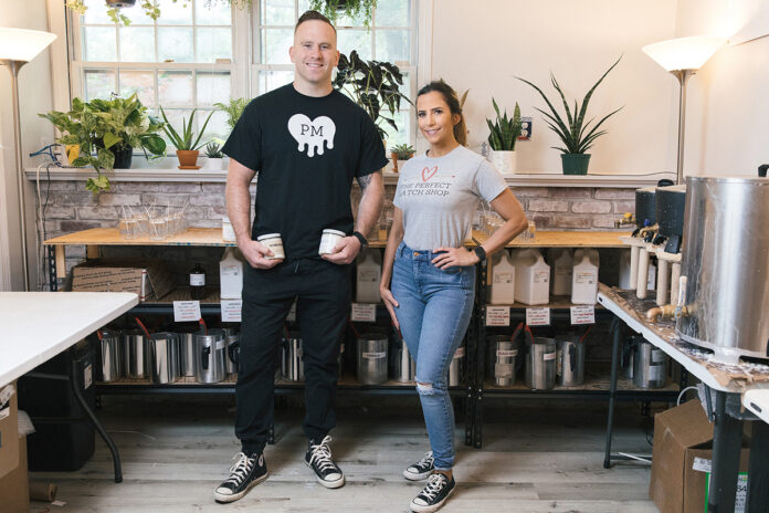 SOLID LAUNCH: The Perfect Match Shop owners Justin Skory and Cierra Fasulo have sold about 10,000 candles since opening the Warwick business in March. / PBN PHOTO/RUPERT WHITELEY