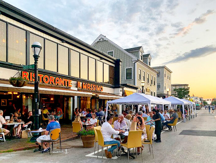"""AVE. VENUE: Patrons fill tables outside Ristorante Il Massimo in Federal Hill in Providence as part of the """"Al Fresco On The Hill"""" dining initiative launched in June. / COURTESY FEDERAL HILL COMMERCE ASSOCIATION"""