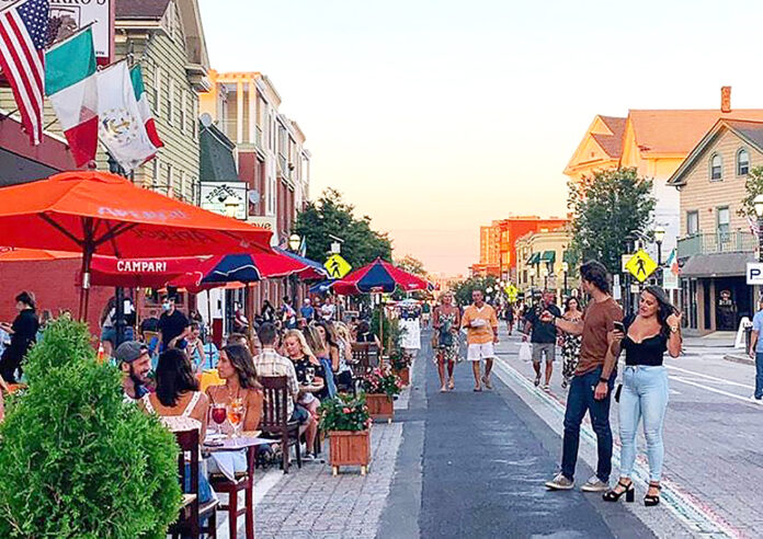 """ITALIAN FLAVOR: Restaurants along the normally heavily trafficked Atwells Avenue in Providence have reported about 90% of their capacity booked in advance during the recently launched """"Al Fresco On The Hill"""" dining initiative. / COURTESY FEDERAL HILL COMMERCE ASSOCIATION"""