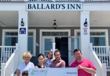PICTURED IN FRONT of Ballard's Inn are, from left to right, Marion Filippi, Landon, Lauren, Natalie and Steven Filippi, along with Bryan Sawyer, COO of the Gloria Gemma Breast Cancer Resource Foundation. / COURTESY STEVEN FILIPPI/BLAARD'S INN