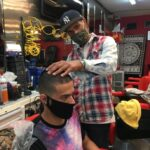 VICTOR CURET (right), owner of Gentleman's Quarters Barbershop, is offering free haircuts to people experiencing financial hardship. / COURTESY VICTOR CURET