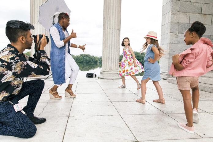 ON LOCATION: Donahue Models & Talent owner Yemi Sekoni directs, from left, Ruby Boesch, Molly McBride and Jazzy Rosa during a recent photo shoot at the Temple to Music in Roger Williams Park in Providence. The photographer is Yan La Mort. / PBN PHOTO/RUPERT WHITELEY