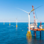 OPENING THE GATE: Deepwater Wind LLC completed the Block Island Wind Farm, pictured, in 2016. In June, the first utility-scale wind farm, an 84-turbine project called Vineyard Wind proposed off Martha's Vineyard, received a favorable preliminary analysis from the Bureau of Ocean Energy Management, paving the way for future wind farms to begin ­spinning. / COURTESY DEEPWATER WIND LLC