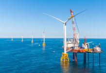 OPENING THE GATE: Deepwater Wind LLC completed the Block Island Wind Farm, pictured, in 2016. In June, the first utility-scale wind farm, an 84-turbine project called Vineyard Wind proposed off Martha's Vineyard, received a favorable preliminary analysis from the Bureau of Ocean Energy Management, paving the way for future wind farms to begin spinning. / COURTESY DEEPWATER WIND LLC