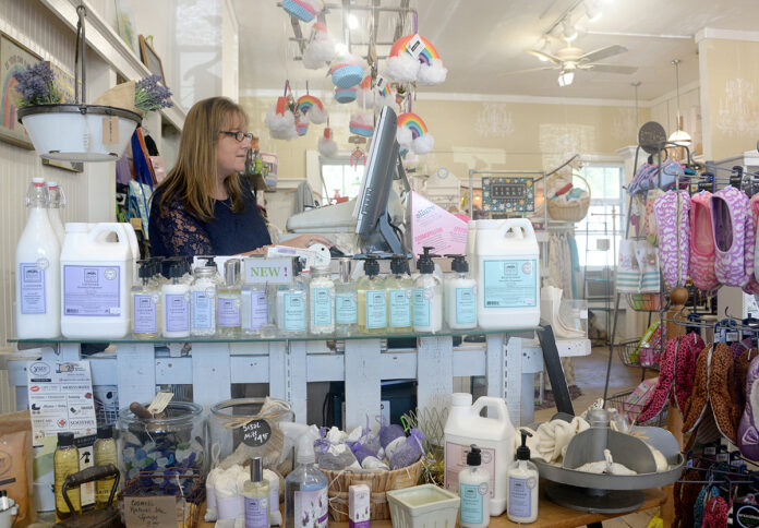SALES BOOST: Lori Lyons, owner of Beauty and the Bath in North Kingstown, says after boosting the online presence of her gift store as a result of participating in the R.I. Commerce Corp.'s Small Business Technical Support program, she's expanded the reach of her business and increased her sales by 25%. / PBN PHOTO/ELIZABETH GRAHAM