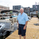 INCREASING NUMBERS: Richard Cromwell now has more than 400 members and a fleet of 70 boats throughout the four Freedom Boat Club franchises he owns in Rhode Island. He is pictured at the Newport club. / PBN PHOTO/KATE WHITNEY LUCEY