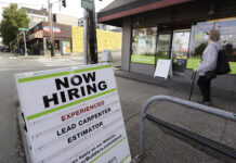 U.S. JOBLESS CLAIMS totaled 963,000 last week. / AP FILE PHOTO/ELAINE THOMPSON