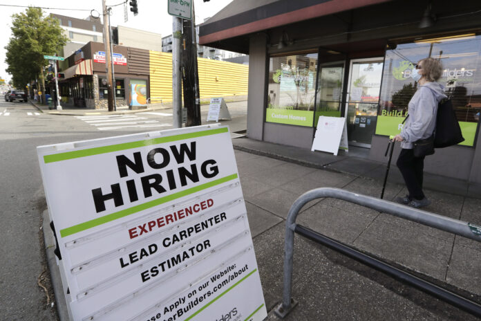 U.S. JOBLESS CLAIMS totaled 963,000 last week. / AP FILE PHOTO/ELAINE THOMPSON