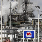 UNCHECKED? A Marathon Petroleum Corp. refinery in Detroit on April 21. Thousands of oil and gas operations and other sites won permission to bypass rules intended to protect health and the environment because of the coronavirus outbreak, The Associated Press has found.  / AP FILE PHOTO/PAUL SANCYA