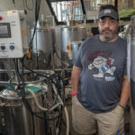 BITTER SITUATION: Providence Brewing Co. owner Efren Hidalgo has received an eviction notice from his landlord for his North Providence brewery. Without enough money to move his equipment to a new location, Hidalgo is worried that if he is forced from his North Providence location immediately, he will default on his sales contracts. / PBN PHOTO/MICHAEL SALERNO