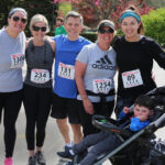 FUN RUN: South County Health staffers, from left, Claire Mathews, Jill Niedman, Dr. Rob Gianfranco, Christine Stout, Paige Damle, and Mathews' son, Jaxson, participated in the health care providers' inaugural Centennial 5K last year to help raise money for its cardiac rehab center. / COURTESY SOUTH COUNTY HEALTH