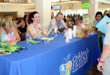 SPREADING THE WORD: Children's Friend staffers, from left, Kristen Caine, Jennifer Paradis and Rebecca Paquette offer health information during the organization's Wellness Fair during Children's Friend annual staff summer outing at Rhode Island College last year. / COURTESY CHILDREN'S FRIEND