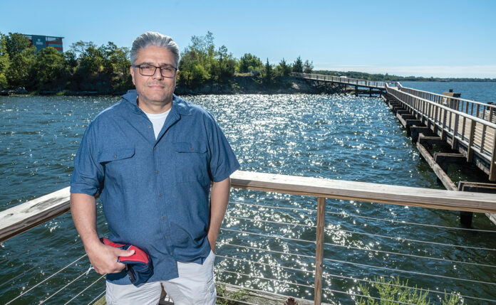NEW USES: East Providence Mayor Roberto DaSilva says waterfront redevelopment will help the city attract more residents and visitors. He's pictured on a public pier at the Kettle Point development. / PBN FILE PHOTO/ MICHAEL SALERNO