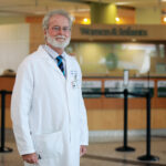 """UNDER PRESSURE: Dr. Raymond Powrie, Care New England's chief of medicine, acknowledges that financially """"hard decisions have been made"""" during the pandemic.  / PBN PHOTO/PAMELA BHATIA"""