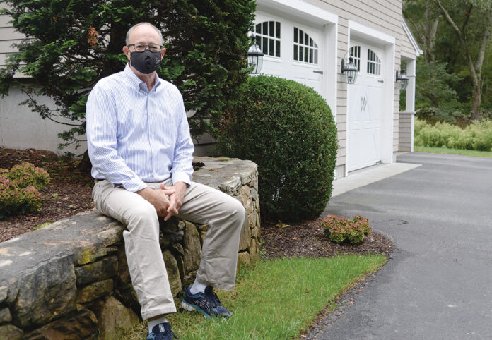 WORTH THE RISK? Even Mark A. Male, executive vice president of the Independent Insurance Agents of Rhode Island, sometimes finds himself wondering if he should pay for flood coverage on his South Kingstown house that isn't in a high-risk area. / PBN PHOTO/ELIZABETH GRAHAM