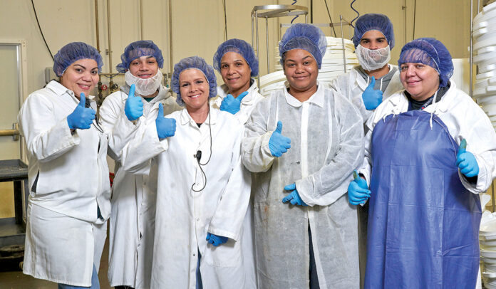 PREP WORK: Employees who work in Blount Fine Foods Corp.'s preparation room give a thumbs-up.