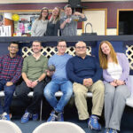 BIRTHDAYS AND BOWLING: Members of the Brave River Solutions Inc. team have fun with a celebration of January birthdays with some bowling. 