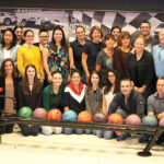 READY TO ROLL: The staff from Brokers' Service Marketing Group LLC enjoys its 2019 company outing near the bowling lanes at R1 Indoor Karting in Lincoln. COURTESY BROKERS' SERVICE MARKETING GROUP LLC