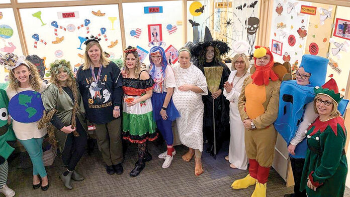 TRICK OR TREAT: Employees at Brown Medicine compete with a theme to win the best costume. The winning practice/department receives a pizza party and is recognized in the president's monthly presentation. / COURTESY BROWN MEDICINE