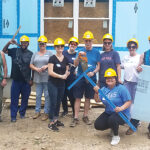 BUILDING BLOCKS: AAA Northeast employees volunteer to build a home for Habitat for Humanity. / COURTESY AAA NORTHEAST