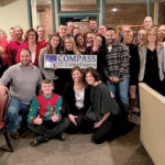 HOLIDAY SPIRIT: Compass IT Compliance LLC employees gather during a Christmas party. 