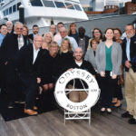 CRUISING ALONG: Custom Computer Specialists Inc. employees gather for a cruise in Boston in 2018.COURTESY CUSTOM COMPUTER SPECIALISTS INC.