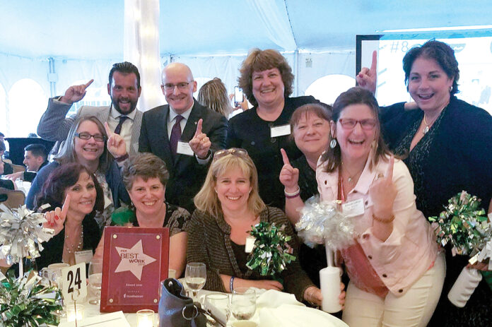 TIME TO PARTY: Edward Jones employees celebrate during Providence Business News' Best Places to Work awards ceremony in 2019. / COURTESY EDWARD JONES