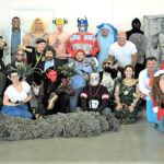 ALL DRESSED UP: Employees for Envision Technology Advisors LLC wear costumes during the company's annual Halloween event in 2019. 