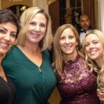 HAPPY HOLIDAYS: Staffers with Kahn, Litwin, Renza & Co. Ltd. attend a holiday party. / COURTESY KAHN, LITWIN, RENZA & CO. LTD.