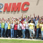GROWING UP: National Marker Co. employees are happy about breaking sales records for the last three months at the North Smithfield-based manufacturer. COURTESY NATIONAL MARKER CO.