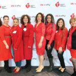 SEEING RED: Providence Community Health Centers Inc. employees wear red and attend a previous American Heart Association Go Red for Women luncheon. / COURTESY PROVIDENCE COMMUNITY HEALTH CENTERS INC.