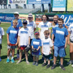 FIELD DAY: Automated Business Solutions Inc. employees and their families enjoy the company's Family Day and Kids Softball Game at McCoy Stadium in Pawtucket. 