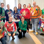 "BEST-DRESSED: Rubius Therapeutics employees participate in a ""Best Sweater"" contest it held on behalf of the activities team in late 2019. It was accompanied by a ""Giving Tree"" for local families in need. / COURTESY RUBIUS THERAPEUTICS"