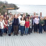 NICE RETREAT: Sansiveri, Kimball & Co. LLP employees enjoy a day by the water at its annual all-employee firm retreat and holiday party at the Squantum Club in East Providence.  / COURTESY SANSIVERI, KIMBALL & CO. LLP